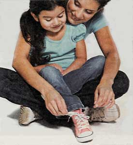 mom helping girl lace up pink high top chucks