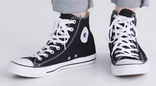 wearing black high top chucks