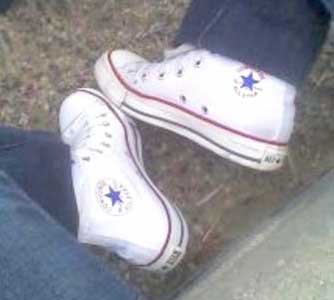 wearing optical white high top chucks
