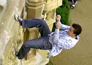 Agent Cody Banks climbing a London building.
