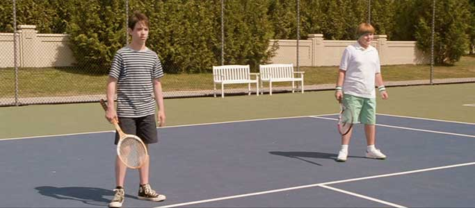 Greg and Rowley play their first tennis match.