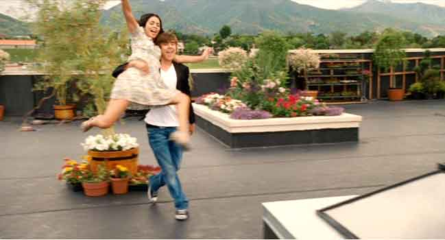 Troy and Gabriella sing and dance in a rooftop garden
