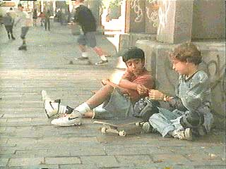 Patrick and Omri exchanging cards on the street