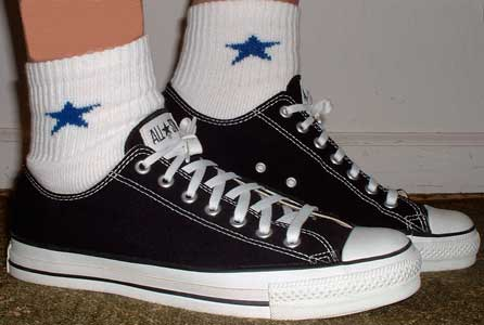 Embroidered star socks worn with black low cut chucks