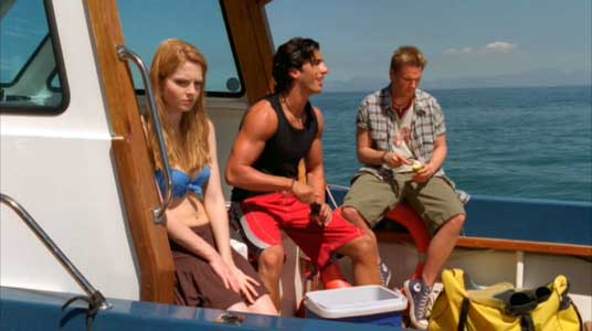 Danielle, JT and Shane sit on the boat