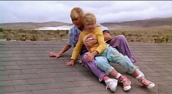 Nancy and Mindy climb onto the roof of their house