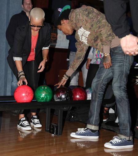8a6d2df2ead4ea 8 Wiz Khalifa Wiz Khalifa wearing black low cut chucks while bowling.  Another bowler is wearing black low cut chucks.